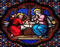Nativity Scene, stained glass window in the Basilica of Saint Clotilde in Paris Royalty Free Stock Photo