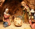 Nativity scene with statues of hand decorated pottery in the manger Royalty Free Stock Photo