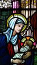 The nativity in stained glass birth of jesus mary holding jesus a photo Stock Image
