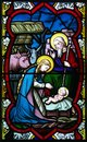 Nativity stained glass colorful victorian window depicting holy family joseph mary and jesus in scene with animals present Royalty Free Stock Images