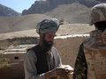 Nato soldier obtaining info in Afghanistan Royalty Free Stock Image