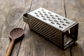 Natural aged old rusted grater on the wooden table Stock Images