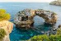 Natural arch in mallorca es pontas cala santanyi majorca spain Royalty Free Stock Image