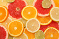Natural background made slices different citrus fruits Royalty Free Stock Image
