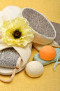Natural bath sponges bath slippers pumice bath bombs salt on the yellow background Stock Photos