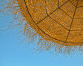 Natural beach umbrella on blue sky closeup Royalty Free Stock Image