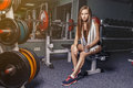 Natural beautiful real sporty girl resting on the preacher curl bench Royalty Free Stock Photo