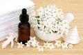 Natural beauty treatment aromatherapy health with jasmine flowers essential oil bottle and bathroom accessories Royalty Free Stock Photography