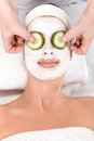Natural beauty treatment with facial mask Stock Images