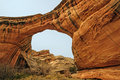 Natural bridge in a desert canyon low view of sipapu bridges national monument utah Stock Image