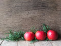 Natural christmas decoration with apples red and green juniper branches on a wooden background copyspace Stock Photos
