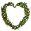 Natural christmas wreath heart shaped floral with mistletoe ivy fir and pine cones over white background Royalty Free Stock Photos