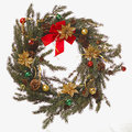 Natural christmas wreath a made from pine tree limbs and ornaments with a red bow Stock Image