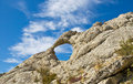 Natural circular hole in the mountain eltigen crimea Stock Image