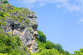 Natural cliff in the shape of a human head Royalty Free Stock Photo