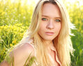 Natural close up portrait of a attractive girl in spring meadow on the Royalty Free Stock Photos