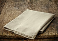 Natural cotton napkin on old wooden table Royalty Free Stock Image