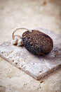 Natural dark pumice on a stone background Royalty Free Stock Images