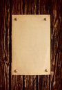 Natural distressed wooden board with paper