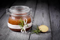 Natural diy ginger sugar and salt body scrub handmade with rosemary almond coconut oil Royalty Free Stock Photography