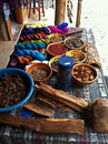 Natural dyes and hand spun yarn a display of with the material that makes the colors in a market in guatemala lake atitlan Stock Image