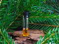 Natural fir oil in a mini bottle. A massage oil.