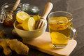 Natural flu killers hot lemon tea with ginger and honey on the table Stock Photo