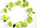 Natural food design with green apples and leaves white desk background top view mock up