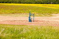 Natural gas wellhead Alberta Canada grassland Royalty Free Stock Photo