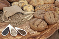Natural goodness seeded bread roll selection with wheat sheaths rye grain in a hessian sack with chia sunflower and caraway seed Royalty Free Stock Photo