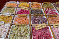 Natural gummy different flavors sales stand at outdoor market sweet jelly bean artisans in various colors shapes and fruit Stock Photos