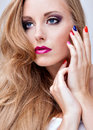 Natural health beauty of a woman face with multicolored make up Stock Photography