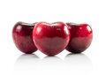 Natural heart shape from cherry fruit isolated on white Royalty Free Stock Photos