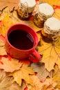 Natural homemade treats autumn season keep healthy. Set three jams honey natural sweets in jars and mug of tea Royalty Free Stock Photo