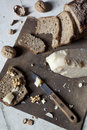 Natural homemade wholemeal sliced bread on vintage box with walnuts and parmesan cheese Royalty Free Stock Photo