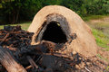 Natural incinerator that it made from clay to burn firewood Royalty Free Stock Photo