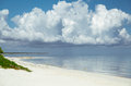 Natural landscape view of Cayo Coco Cuban island beach and tranquil ocean with huge, giant white floating cloud above the water Royalty Free Stock Photo