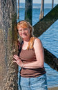 Natural Looking Middle Aged Woman Portrait with Ocean Pillings Royalty Free Stock Photo