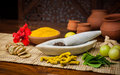 Natural medicine a selection of ingredients arranged in and around a marble mortar and pestle Stock Photos
