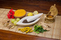 Natural medicine a selection of ingredients arranged in and around a marble mortar and pestle Stock Photography