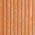 Natural old wood fence planks wooden close board texture overlapping light reddish brown closeboard terracotta background vertical Royalty Free Stock Photo