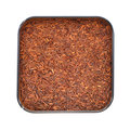 Natural organic rooibos in a tin. Royalty Free Stock Photos