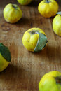 Natural quince on an old wooden table food Royalty Free Stock Image