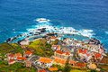 Natural rock pool porto moniz madeira view of the village of with lava island portugal Stock Photo
