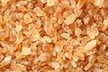 Natural rock sugar close up golden color Royalty Free Stock Images