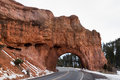 Natural sandstone bridge a road built through a in red canyon dixie national forest utah Stock Photos