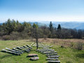 Natural seat scenic view of the carpathian forests with benches in a amphitheater Stock Image