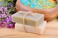 Natural soaps with bath salt on a wooden background Stock Photos