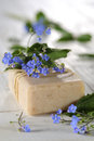 Natural soaps with flower on white wooden table Stock Photos