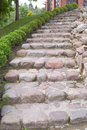 Natural stone steps along a flowerbed Royalty Free Stock Images